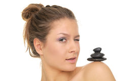 Woman holding pile of stones on the shoulder Royalty Free Stock Photography