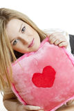 Woman holding a pillow Royalty Free Stock Photo