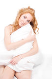 Woman holding pillow Royalty Free Stock Images