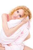 Woman holding pillow Stock Image