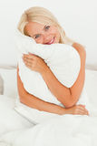 Woman holding a pillow Stock Image