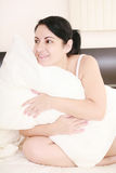 Woman holding a pillow Royalty Free Stock Image
