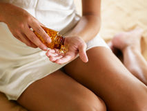 Woman holding pills stock photography