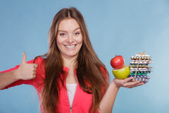 Woman holding pills and fruits. Health care Stock Images