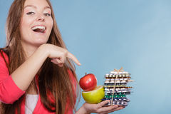 Woman holding pills and fruits. Health care Royalty Free Stock Photography