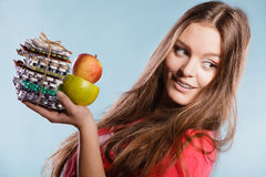 Woman holding pills and fruits. Health care Royalty Free Stock Image