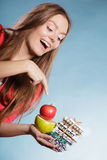 Woman holding pills and fruits. Health care Royalty Free Stock Images