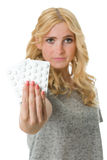 Woman holding pills in hand Stock Photography