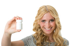 Woman holding pills in hand Royalty Free Stock Image
