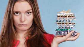 Woman holding pills tablets. Drug addict. Stock Images
