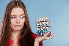 Woman holding pills tablets. Drug addict. Woman holding pills. Girl female with stack of tablets. Drug addict and health care concept. Overdose Stock Images