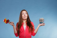 Woman holding pills and vegetables. Health care Royalty Free Stock Image