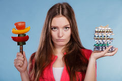 Woman holding pills and vegetables. Health care Royalty Free Stock Photos