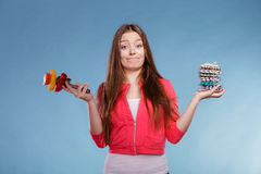 Woman holding pills and vegetables. Health care Royalty Free Stock Images