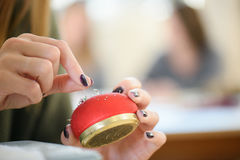 Woman holding pin cushion Royalty Free Stock Images