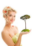 Woman holding pine-tree Royalty Free Stock Photo
