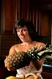 Woman holding a pineapple Royalty Free Stock Photography