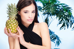 Woman holding pineapple Royalty Free Stock Photography