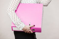 Woman holding pink binder with documents Royalty Free Stock Images
