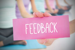 Woman holding pink card saying feedback Royalty Free Stock Image
