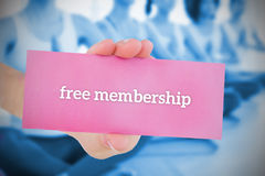 Woman holding pink card saying free membership Stock Photos