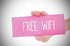 Woman holding pink card saying free wifi Stock Photo