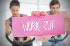 Woman holding pink card saying work out Stock Photo