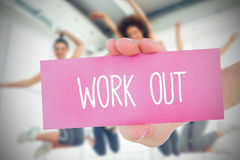 Woman holding pink card saying work out Stock Photos