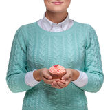 Woman holding a pink cupcake on white Stock Photo