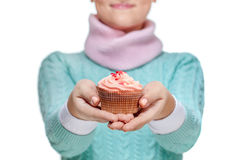 Woman holding a pink cupcake on white Stock Photography