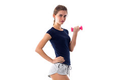Woman holding a pink dumbbell Royalty Free Stock Image