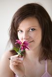 Woman holding pink flower Royalty Free Stock Photos