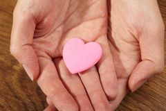 Woman holding pink heart Stock Images