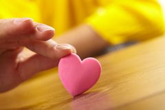 Woman holding pink heart Royalty Free Stock Photo