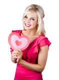 Woman holding a pink heart-shape Royalty Free Stock Photo