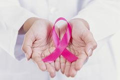 Woman holding pink ribbon. symbol of breast cancer awareness. And international women day campaign stock photos