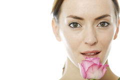 Woman holding a pink rose Stock Image