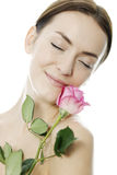 Woman holding a pink rose stock photography