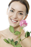 Woman holding a pink rose Stock Images