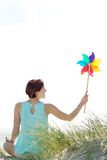 Woman holding pinwheel outdoors Royalty Free Stock Photography