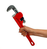 Woman holding pipe wrench Stock Photos