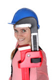 Woman holding pipe wrench Stock Photo