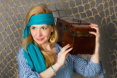 Woman holding a pirate with a chest Royalty Free Stock Image