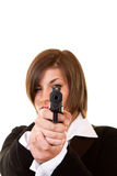 Woman holding a pistol. Close-up of a  woman holding pistol pointing focusing on you Stock Photo