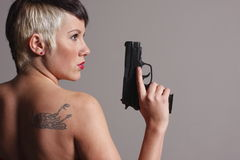 Woman holding pistol royalty free stock photography