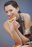 Woman holding pizza Royalty Free Stock Photo