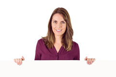 Woman holding placeholder in her hands Royalty Free Stock Photography