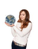 Woman holding planet Earth. Stock Image