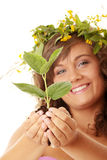 Woman holding plant Stock Images