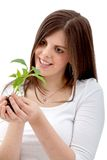 Woman holding a plant Stock Images